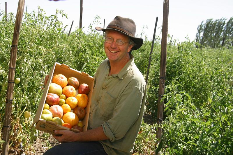 Farmer with produce, grown with SF compost; photo by Larry Strong, courtesy Recology
