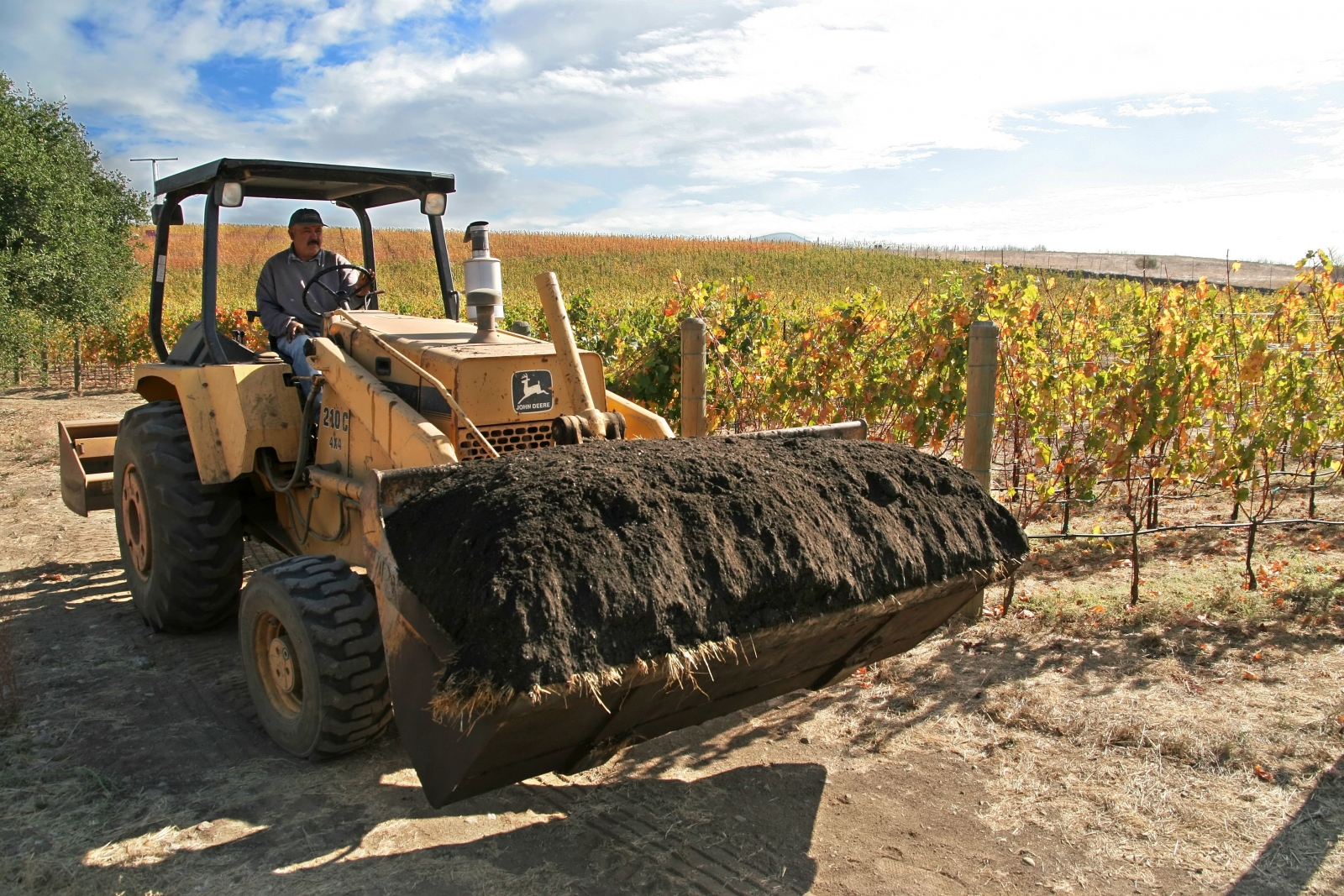 Farmer applies SF compost to crops; photo by Larry Strong, courtesy Recology