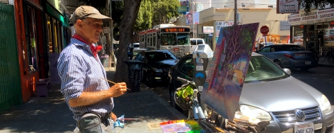artist paints street scene in the mission district