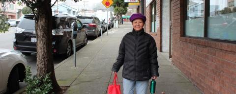 photo of resident with reusable mug and bag