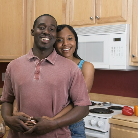 photo of couple standing in the kitchen of their home