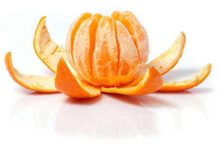 photo of an orange, peeled open