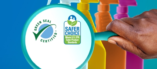 Hand holding magnifying glass over cleaning product bottles